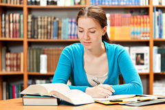 Girl studying in library Stock Photo