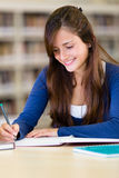 Girl studying at the library Stock Photo