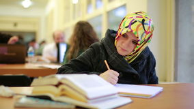 Girl studying in library stock footage
