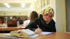 Girl studying in library Stock Photos