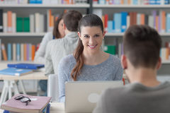 Girl studying in the library Royalty Free Stock Photos