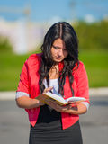 Girl studying outdoor Stock Images