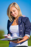 Girl studying outdoor Royalty Free Stock Photos