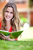 Girl studying outdoors Stock Photos