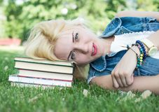 Girl studying outdoors with Royalty Free Stock Photos