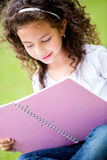 Girl studying at the park Royalty Free Stock Image
