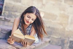Girl studying and reading a book. Relax, rest, education concept, recreation . Young attractive girl studying and reading a book . Relax, rest, education Royalty Free Stock Image