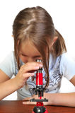Girl Studying Something With Microscope Royalty Free Stock Image