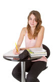 Girl studying by table Stock Photography