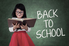 Girl studying with a text of back to school Royalty Free Stock Image