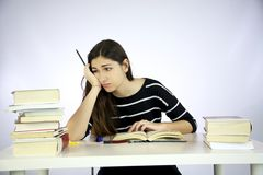 Girl studying unhappy and depressed Stock Image