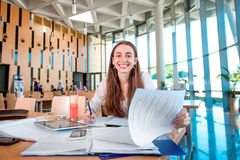 Girl studying in the University canteen Royalty Free Stock Photos