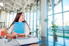 Girl studying in the University canteen Stock Images