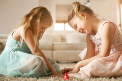 Girl stuff. Little sisters have play together. Two little girls painted their nails at home. Close up image Royalty Free Stock Images
