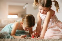 Girl stuff.  Sisters have play together. Stock Photography