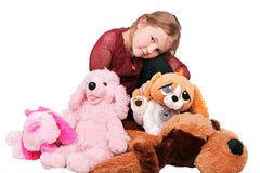 Girl and stuffed animals. Young little girl sitting with stuffed animals Stock Images