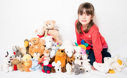 Girl with stuffed animals Royalty Free Stock Photo