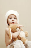Girl with stuffed rabbit. One year old toddler girl with a stuffed rabbit Stock Image