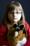 Girl with stuffed toy Stock Photos
