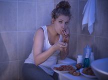 Girl stuffing with spaghetti Stock Images