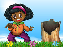 A girl beside the stump Stock Image