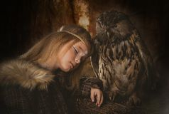 Girl in the style of boho with an owl. Boho chic hugs big owl royalty free stock photos