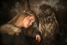Girl in the style of boho with an owl. Boho chic hugs big owl stock images