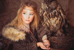 Girl in the style of boho with an owl. Boho chic hugs big owl stock image