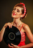 Girl in style holding vinyl record. Stock Image