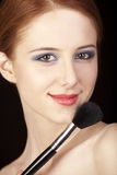 Girl with style make-up and brush. Stock Photo