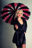 Pin-up girl. American style. Women in Black Coat with Umbrella Stock Photography