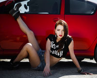 Girl in the style of rock near the car Stock Photo