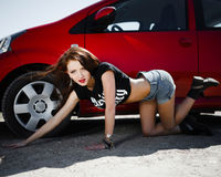 Girl in the style of rock near the car Royalty Free Stock Image