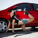 Girl in the style of rock near the car Royalty Free Stock Photography