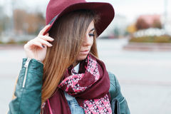 Girl in a stylish burgundy hat Royalty Free Stock Photography