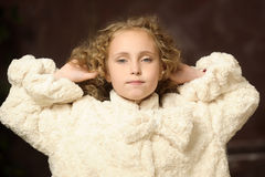 Girl in a stylish coat Stock Images