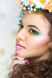 Girl with stylish makeup and flowers Stock Images