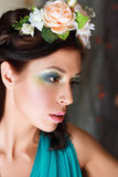 Girl with stylish makeup and flowers Stock Photo