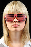 The girl in stylish sunglasses - jalousie Royalty Free Stock Photography