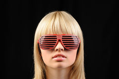 The girl in stylish sunglasses - jalousie Stock Images