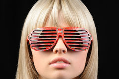 The girl in stylish sunglasses - jalousie Royalty Free Stock Photo