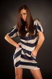 Girl in stylish white-blue dress Royalty Free Stock Photos