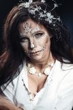 Girl with a stylized make-up of a dead bride. A girl with a stylized make-up of a dead bride. Long-haired brunette in a white shirt Royalty Free Stock Photo