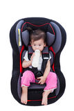 Girl suck up milk at car-seat and fasten seat belt Stock Images