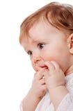 Girl sucking finger. Close up Portrait of baby girl sucking finger isolated on white background Royalty Free Stock Photo