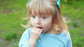 Girl sucking hand on nature stock footage
