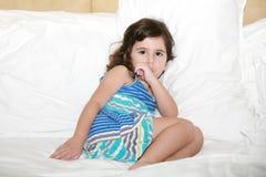 Girl sucking her thumb. Beautiful baby girl sucking her thumb just before bedtime Stock Photography