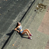 Girl sucking lollipop Stock Photography