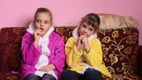 Girl sucking lollipops stock video footage