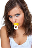 Girl sucking a pacifier royalty free stock photo
